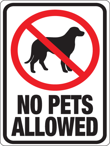 A black and white sign prohibits pets and contains the silhouette of a dog within a red circle with a cross through it.