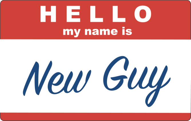 "A red ""Hello my name is sticker"" is filled in with handwritten blue script reading ""New Guy""."